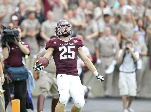 Texas A&M wide receiver Ryan Swope (25) celebrates his 80 yard pass for touchdown during the second half of a college football game at Kyle Field, Saturday, Sept. 29, 2012, in College Station. Photo: Karen Warren, Houston Chronicle / © 2012  Houston Chronicle
