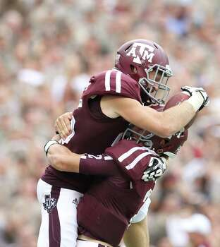 A&M 58, Arkansas 10Texas A&M wide receiver Ryan Swope (25) celebrates his 80 yard pass for touchdown with quarterback Johnny Manziel (2) during the second half of a college football game at Kyle Field, Saturday, Sept. 29, 2012, in College Station. Photo: Karen Warren, Houston Chronicle / © 2012  Houston Chronicle
