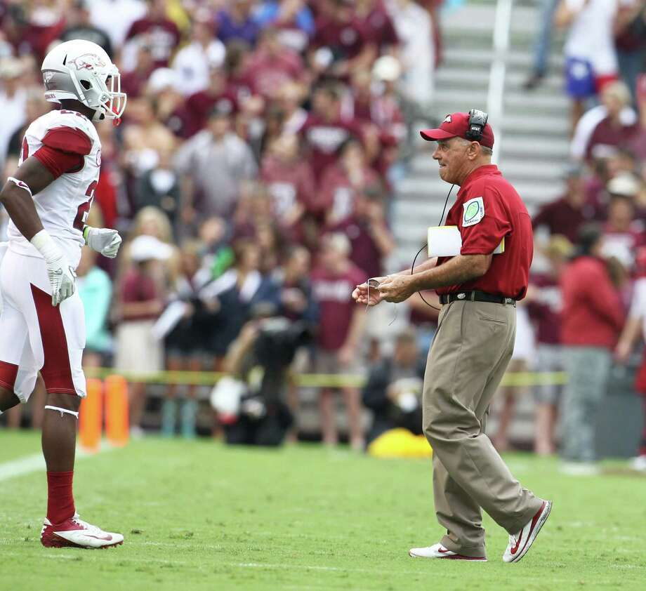 Arkansas head coach John L. Smith during a time out during the first half of a college football game at Kyle Field, Saturday, Sept. 29, 2012, in College Station. Photo: Karen Warren, Houston Chronicle / © 2012  Houston Chronicle