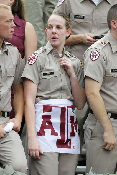 A cadet in the stands during the first half of a college football game at Kyle Field, Saturday, Sept