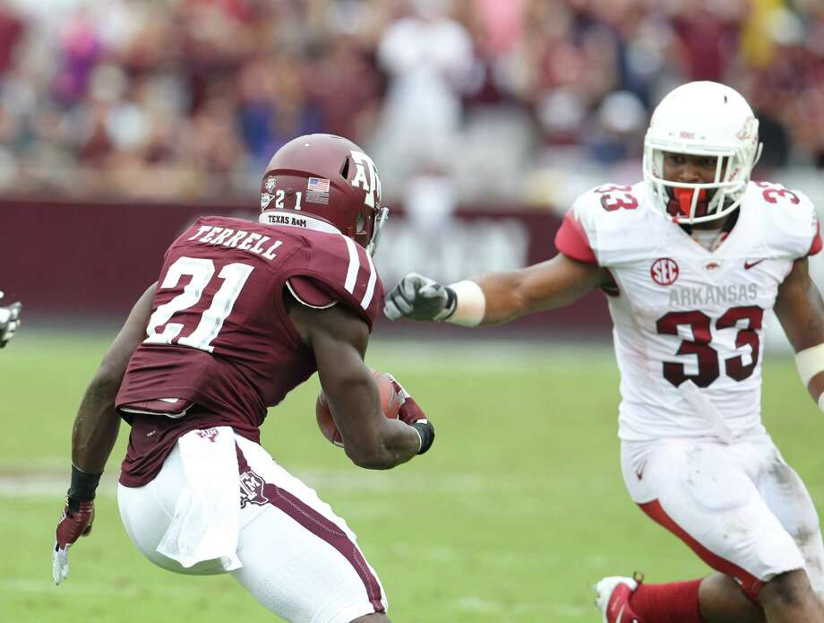 Texas A&M defensive back Steven Terrell (21) runs the ball back against Arkansas running back Dennis Johnson (33) on an interception during the second quarter of a college football game at Kyle Field, Saturday, Sept. 29, 2012, in College Station. Photo: Karen Warren, Houston Chronicle / © 2012  Houston Chronicle