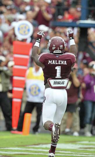 Texas A&M running back Ben Malena (1) celebrates his 11-yard pass touchdown during the second quarte