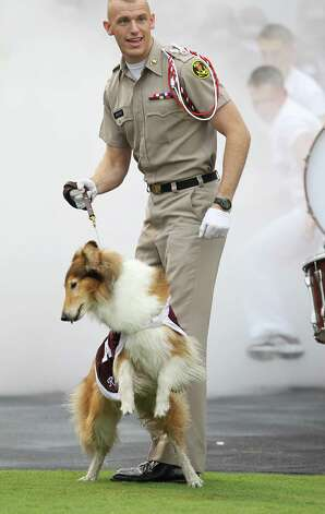 Texas A&M cadet Daylon Koster runs in front of the team with Reveille before the start of a college football game at Kyle Field, Saturday, Sept. 29, 2012, in College Station. Photo: Karen Warren, Houston Chronicle / © 2012  Houston Chronicle