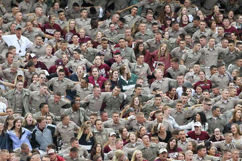 Texas A&M students and cadets cheer before the start of a college football game at Kyle Field, Satur