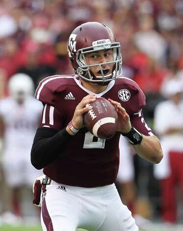 Texas A&M quarterback Johnny Manziel (2) looks to pass during the first quarter of a college football game at Kyle Field, Saturday, Sept. 29, 2012, in College Station. Photo: Karen Warren, Houston Chronicle / © 2012  Houston Chronicle