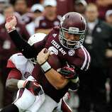 Texas A&M quarterback Johnny Manziel, right, is tackled by Arkansas 's A.J. Turner during the first half of an NCAA college football game Saturday, Sept. 29, 2012, in College Station, Texas. (AP Photo/Pat Sullivan)