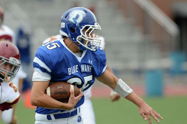 Darien #35 Tommy DiMauro gains yardage as Darien High School hosts St. Joseph High School in varsity football in Darien, CT on Sept. 29, 2012. Photo: Shelley Cryan / Shelley Cryan for the Stamford Advocate/ freelance Shelley Cryan
