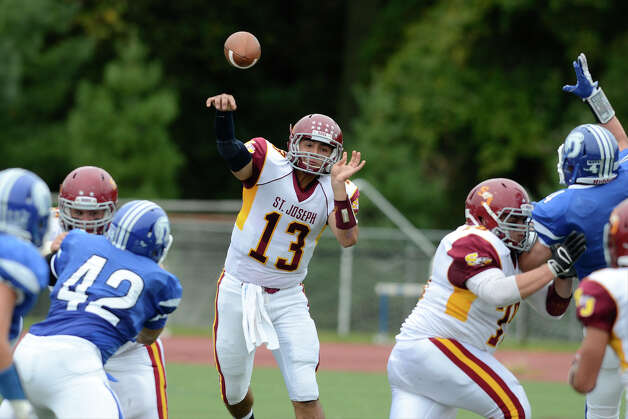 St. Joseph #13 Jordan Vazzano fires a pass as Darien High School hosts St. Joseph High School in varsity football in Darien, CT on Sept. 29, 2012. Photo: Shelley Cryan / Shelley Cryan for the Stamford Advocate/ freelance Shelley Cryan