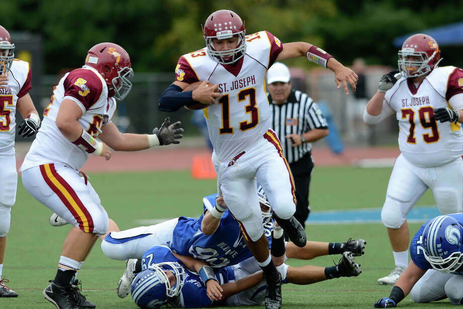 St. Joseph #13 Jordan Vazzano finds an opening as Darien High School hosts St. Joseph High School in varsity football in Darien, CT on Sept. 29, 2012. Photo: Shelley Cryan / Shelley Cryan for the Stamford Advocate/ freelance Shelley Cryan
