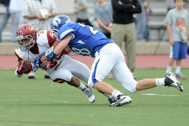 St. Joseph #3 Jake Pelletier and Darien #28 Ian Vanderhorn battle as Darien High School hosts St. Joseph High School in varsity football in Darien, CT on Sept. 29, 2012. Photo: Shelley Cryan / Shelley Cryan for the Stamford Advocate/ freelance Shelley Cryan