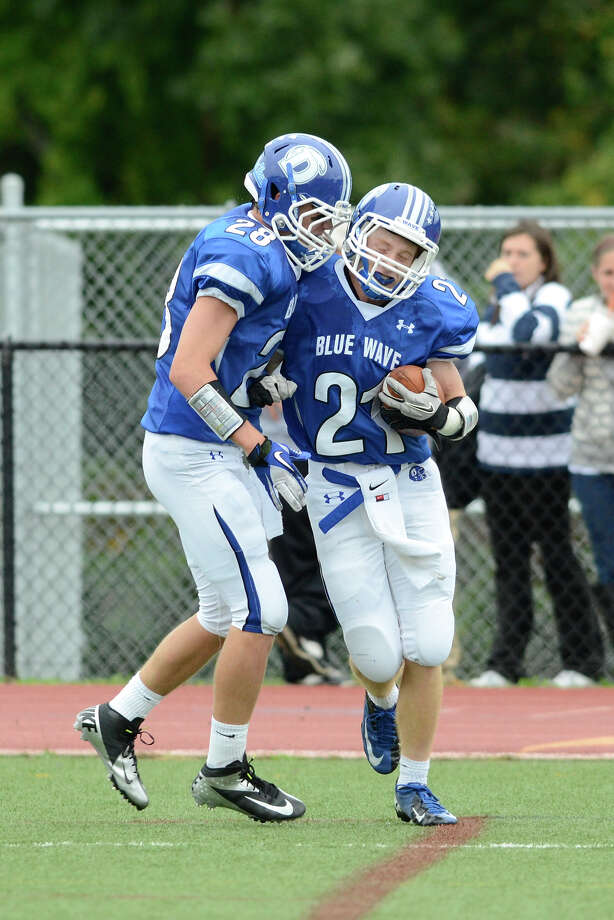 Darien #25 John Reed and #28 Ian Vanderhorn celebrate after a touchdown as Darien High School hosts St. Joseph High School in varsity football in Darien, CT on Sept. 29, 2012. Photo: Shelley Cryan / Shelley Cryan for the Stamford Advocate/ freelance Shelley Cryan