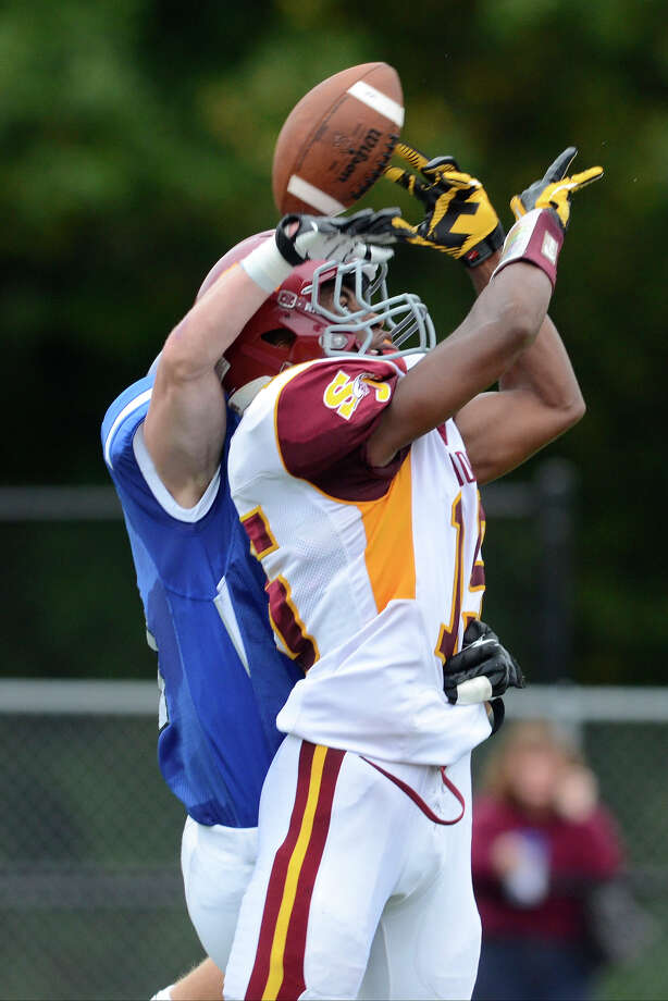 Darien #11 Brian Wiegand and St. Joseph #15 Denzel Moscova vie for the ball, which neither could grab, as Darien High School hosts St. Joseph High School in varsity football in Darien, CT on Sept. 29, 2012. Photo: Shelley Cryan / Shelley Cryan for the Stamford Advocate/ freelance Shelley Cryan