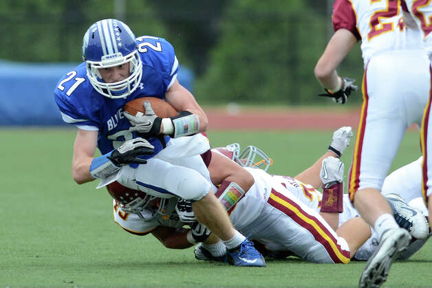 Darien #21 Nicholas Lombardo stretches for extra yardage as Darien High School hosts St. Joseph High School in varsity football in Darien, CT on Sept. 29, 2012. Photo: Shelley Cryan / Shelley Cryan for the Stamford Advocate/ freelance Shelley Cryan