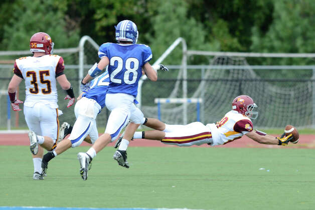 St. Joseph #88 Shane Miller almost pulls down a pass as Darien High School hosts St. Joseph High School in varsity football in Darien, CT on Sept. 29, 2012. Photo: Shelley Cryan / Shelley Cryan for the Stamford Advocate/ freelance Shelley Cryan
