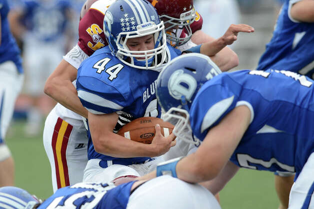 Darien #44 Christian Bognar battles the St. Joseph defense as Darien High School hosts St. Joseph High School in varsity football in Darien, CT on Sept. 29, 2012. Photo: Shelley Cryan / Shelley Cryan for the Stamford Advocate/ freelance Shelley Cryan