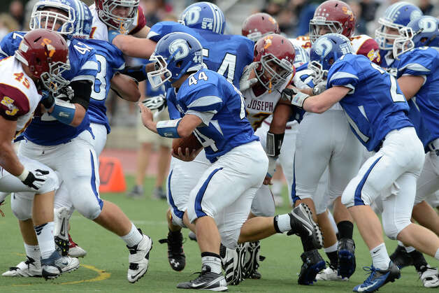 Darien #44 Christian Bognar heads for a first half touchdown as Darien High School hosts St. Joseph High School in varsity football in Darien, CT on Sept. 29, 2012. Photo: Shelley Cryan / Shelley Cryan for the Stamford Advocate/ freelance Shelley Cryan