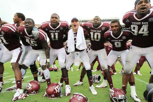 Texas A&M quarterback Johnny Manziel (2) celebrates signing the Aggie War Hymm with the rest of his team after winning against Arkansas 58-10 of a college football game at Kyle Field, Saturday, Sept. 29, 2012, in College Station. Texas A&M beat Arkansas 58-10. Photo: Karen Warren, Houston Chronicle / © 2012  Houston Chronicle