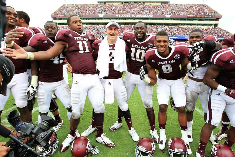Texas A&M quarterback Johnny Manziel (2) celebrates signing the Aggie War Hymm with the rest of his