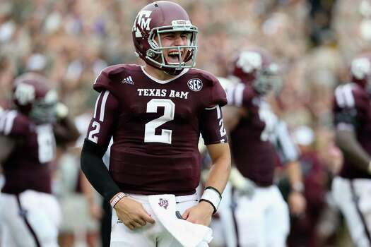 Johnny Manziel #2 of the Texas A&M Aggies celebrates  a touchdown against the Arkansas Razorbacks at Kyle Field on September 29, 2012 in College Station, Texas. Photo: Ronald Martinez, Getty Images / 2012 Getty Images
