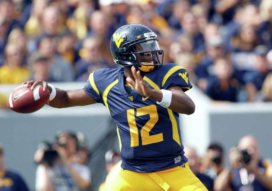MORGANTOWN, WV - SEPTEMBER 29:  Geno Smith #12 of the West Virginia Mountaineers drops back to pass against the Baylor Bears during the game on September 29, 2012 at Mountaineer Field in Morgantown, West Virginia. Photo: Justin K. Aller, Getty Images / 2012 Getty Images