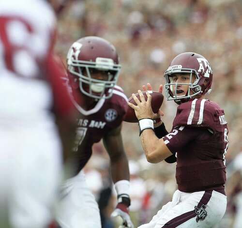 Texas A&M quarterback Johnny Manziel (2) drops back to pass in the fourth quarter of a college football game at Kyle Field, Saturday, Sept. 29, 2012, in College Station. Texas A&M beat Arkansas 58-10. Photo: Karen Warren, Houston Chronicle / © 2012  Houston Chronicle