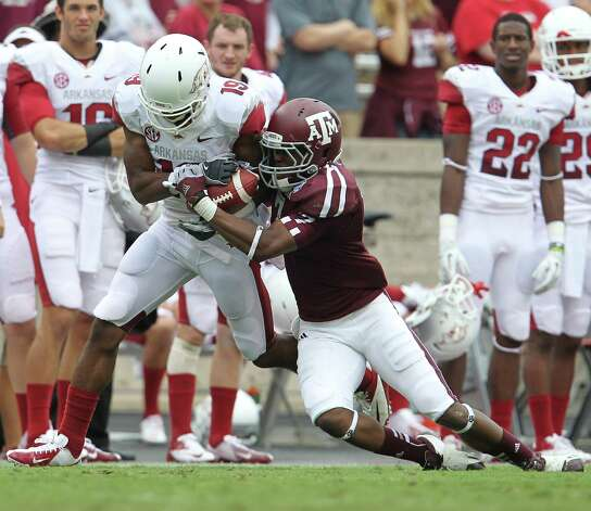 Texas A&M defensive back Tramain Jacobs (7) breaks up a pass intended for Arkansas wide receiver Javontee Herndon (19) during the fourth quarter of a college football game at Kyle Field, Saturday, Sept. 29, 2012, in College Station. Texas A&M beat Arkansas 58-10. Photo: Karen Warren, Houston Chronicle / © 2012  Houston Chronicle