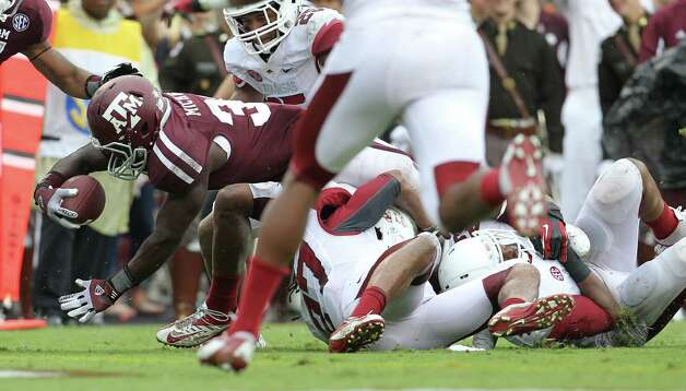 Texas A&M running back Christine Michael (33) dives into the endzone for a touchdown during the third quarter of a college football game at Kyle Field, Saturday, Sept. 29, 2012, in College Station. Photo: Karen Warren, Houston Chronicle / © 2012  Houston Chronicle