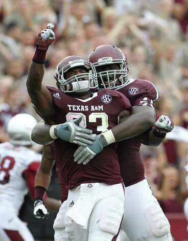 Texas A&M running back Christine Michael (33) celebrates his touchdown with Texas A&M offensive linesman Jarvis Harrison (51)during the third quarter of a college football game at Kyle Field, Saturday, Sept. 29, 2012, in College Station. Photo: Karen Warren, Houston Chronicle / © 2012  Houston Chronicle