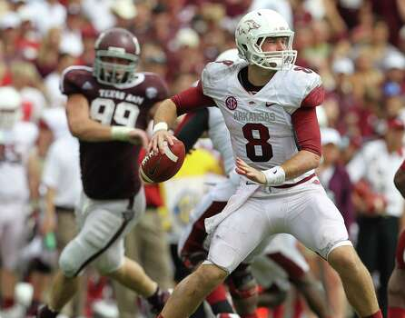 Arkansas quarterback Tyler Wilson (8) drops back to pass during the third quarter of a college football game at Kyle Field, Saturday, Sept. 29, 2012, in College Station. Photo: Karen Warren, Houston Chronicle / © 2012  Houston Chronicle