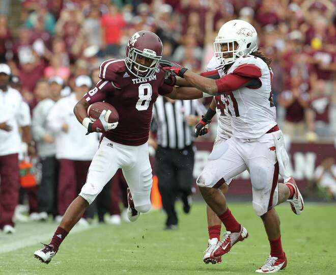 Texas A&M wide receiver Thomas Johnson (8) gains 58 yards against Arkansas safety Alan Turner (27) d
