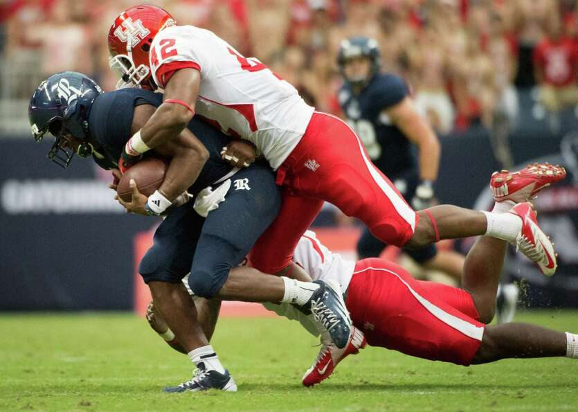 Rice quarterback Driphus Jackson (6) is sacked by Houston linebacker Phillip Steward (42) during the