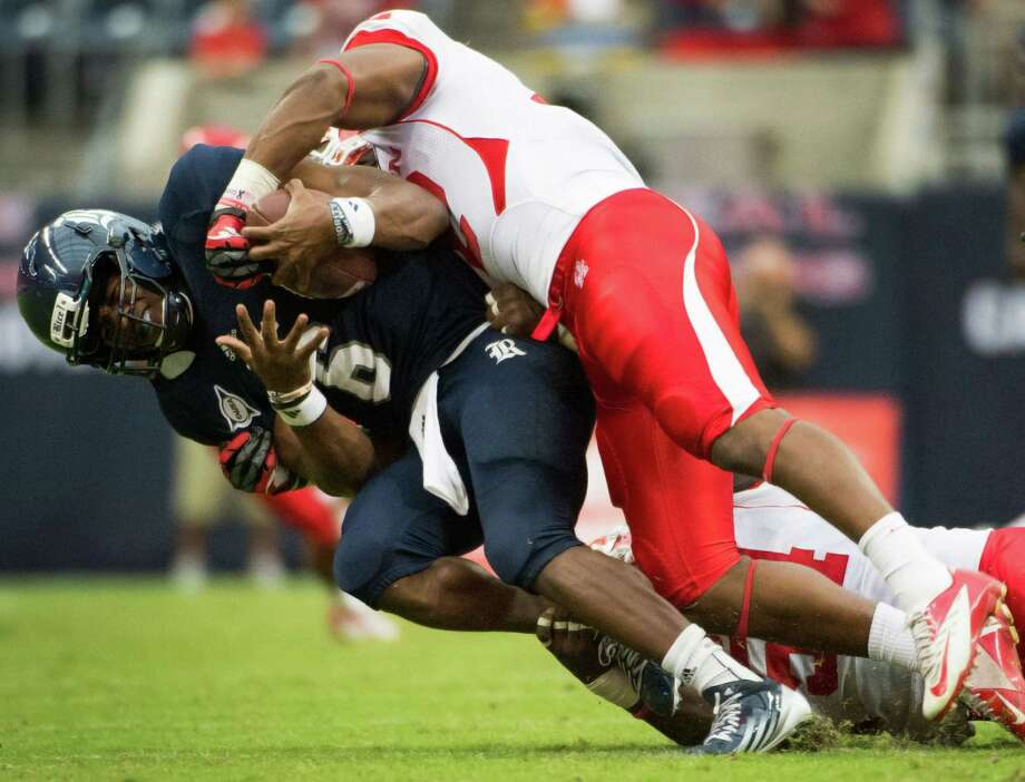 Rice quarterback Driphus Jackson (6) is sacked by Houston linebacker Phillip Steward (42) during the second quarter of the annual Bayou Bucket college football game at Reliant Stadium, Saturday, Sept. 29, 2012, in Houston. Photo: Smiley N. Pool, Houston Chronicle / © 2012  Houston Chronicle