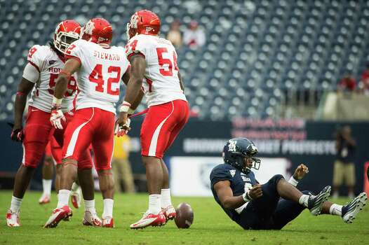 Houston linebacker Phillip Steward (42) celebrates after sacking Rice quarterback Driphus Jackson (6) during the second quarter of the annual Bayou Bucket college football game at Reliant Stadium, Saturday, Sept. 29, 2012, in Houston. Photo: Smiley N. Pool, Houston Chronicle / © 2012  Houston Chronicle
