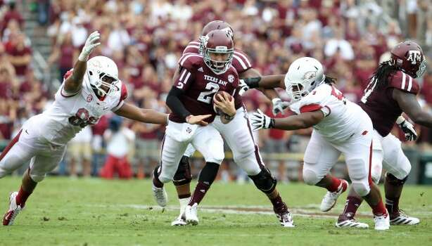Texas A&M quarterback Johnny Manziel (2) scrambles for the quarterback keeper during the first half of a college football game at Kyle Field, Saturday, Sept. 29, 2012, in College Station.  ( Karen Warren / Houston Chronicle ) (Houston Chronicle)