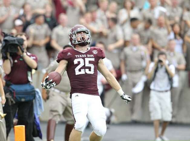 Texas A&M wide receiver Ryan Swope (25) celebrates his 80 yard pass for touchdown during the second half  of a college football game at Kyle Field, Saturday, Sept. 29, 2012, in College Station.  ( Karen Warren / Houston Chronicle ) (Houston Chronicle)