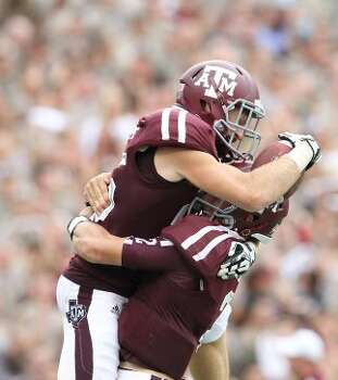 Texas A&M wide receiver Ryan Swope (25) celebrates his 80 yard pass for touchdown with quarterback Johnny Manziel (2) during the second half  of a college football game at Kyle Field, Saturday, Sept. 29, 2012, in College Station.  ( Karen Warren / Houston Chronicle ) (Houston Chronicle)