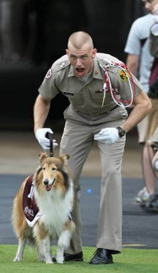 Texas A&M cadet Daylon Koster cheers with Reveille before the start of a college football game at Kyle Field, Saturday, Sept. 29, 2012, in College Station.  ( Karen Warren / Houston Chronicle ) (Houston Chronicle)