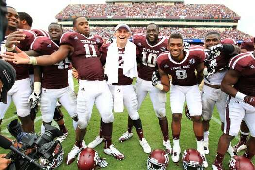 Texas A&M quarterback Johnny Manziel (2) celebrates signing the Aggie War Hymm with the rest of his team after winning against Arkansas 58-10 of a college football game at Kyle Field, Saturday, Sept. 29, 2012, in College Station. Texas A&M beat Arkansas 58-10.  ( Karen Warren / Houston Chronicle ) (Houston Chronicle)