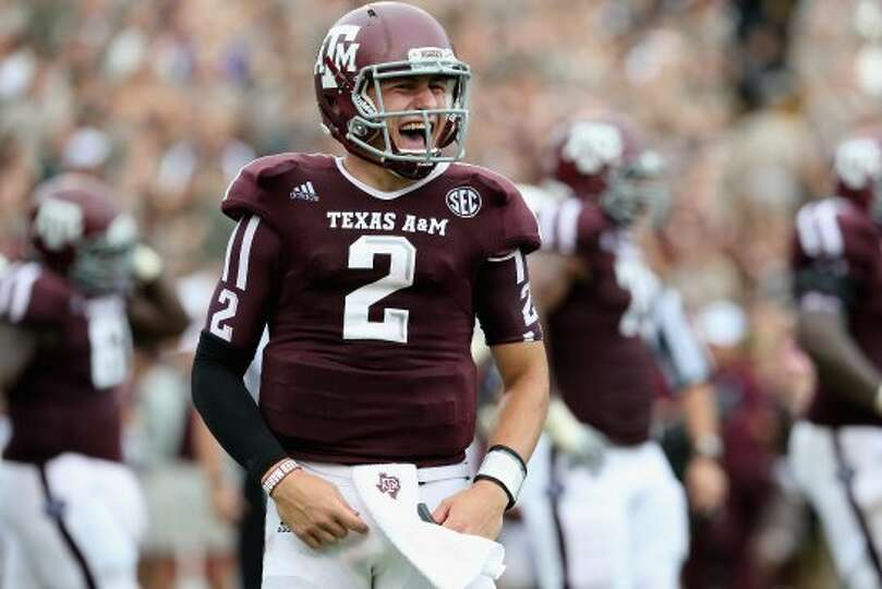 Johnny Manziel of Texas A&M celebrates  a touchdown against  Arkansas at Kyle Field on Sept. 29, 201