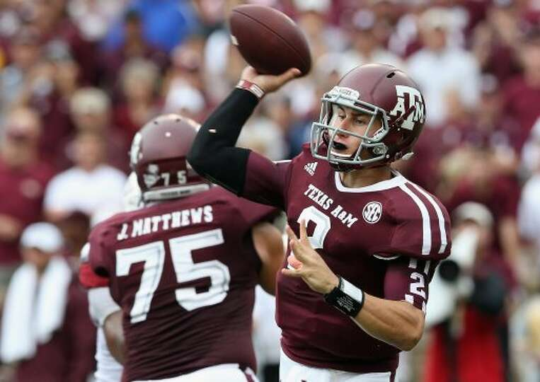 Johnny Manziel of Texas A&M  passes against Arkansas at Kyle Field on Sept. 29, 2012 in College Stat