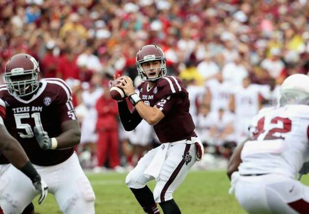 Johnny Manziel passed for 453 yards and three touchdowns and ran for 104 yards and a touchdown as Texas A&M beat Arkansas on Sept. 29, 2012.