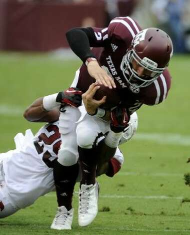 Arkansas cornerback Jared Collins (29) sacks Texas A&M quarterback Johnny Manziel (2) during the first half Saturday, Sept. 29, 2012, in College Station. (Pat Sullivan / Associated Press)