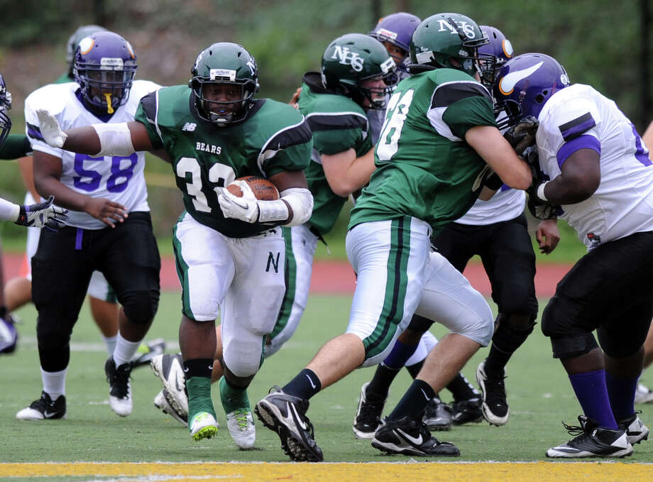 Norwalk's Tomar Joseph carries the ball during Saturday's football game at Westhill High School on September 29, 2012. Photo: Lindsay Niegelberg / Stamford Advocate