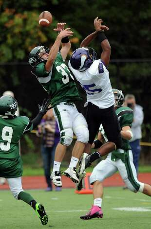 Norwalk's James Marino, left, and Westhill's Yveson Cassamajor both reach for a pass that fell incomplete during Saturday's football game at Westhill High School on September 29, 2012. Photo: Lindsay Niegelberg / Stamford Advocate