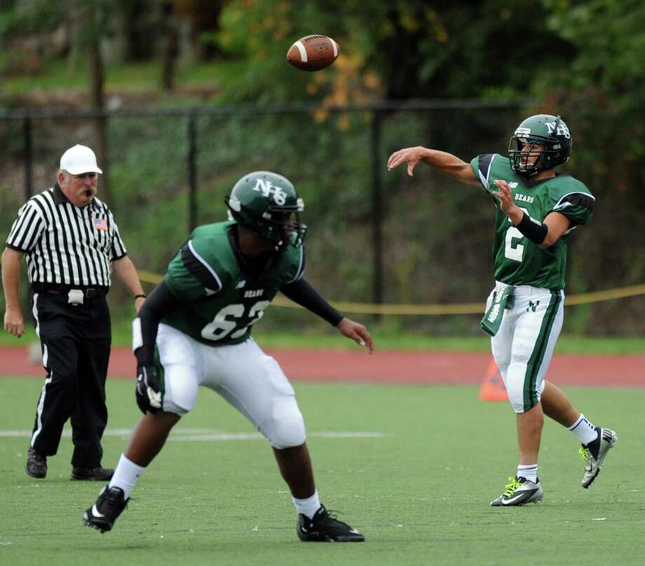 Norwalk's Andy Lovo throws a pass during Saturday's football game at Westhill High School on September 29, 2012. Photo: Lindsay Niegelberg / Stamford Advocate