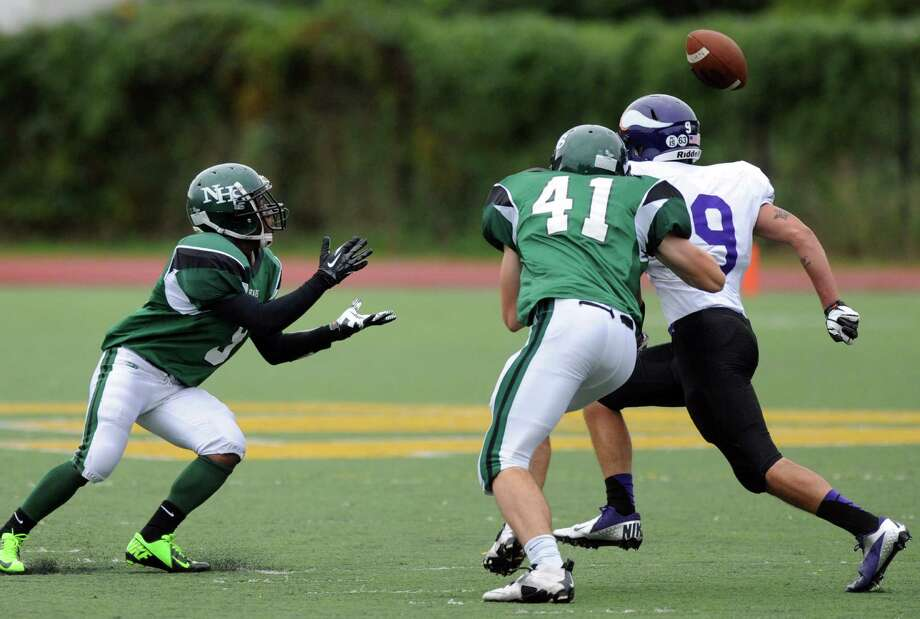 Norwalk's Marc Lerebours makes a catch during Saturday's football game at Westhill High School on September 29, 2012. Photo: Lindsay Niegelberg / Stamford Advocate