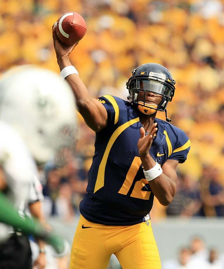West Virginia quarterback Geno Smith tied a conference mark with eight touchdown passes. Photo: Christopher Jackson, Associated Press