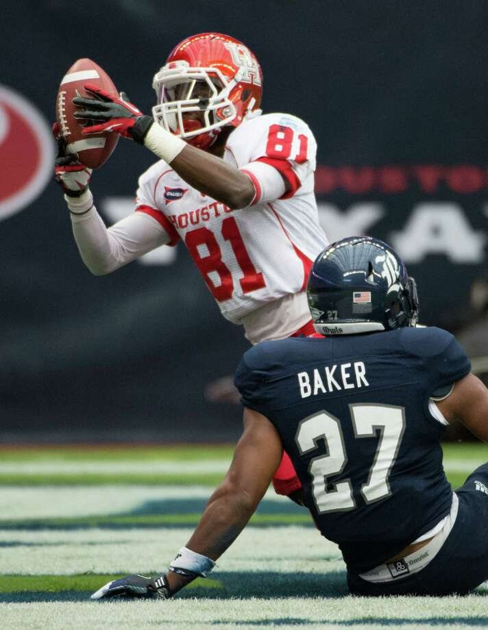 Houston wide receiver Larry McDuffey (81) celebrates after scoring a touchdown past Rice safety Gabe Baker (27) during the first quarter of the annual Bayou Bucket football game at Reliant Stadium, Saturday, Sept. 29, 2012, in Houston. Photo: Smiley N. Pool, Houston Chronicle / © 2012  Houston Chronicle