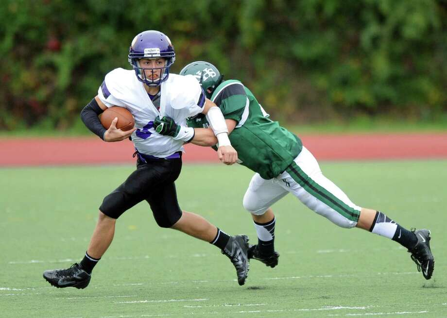Westhill's Ryan Cappola carries the ball during Saturday's football game against Norwalk High School at Westhill High School on September 29, 2012. Photo: Lindsay Niegelberg / Stamford Advocate