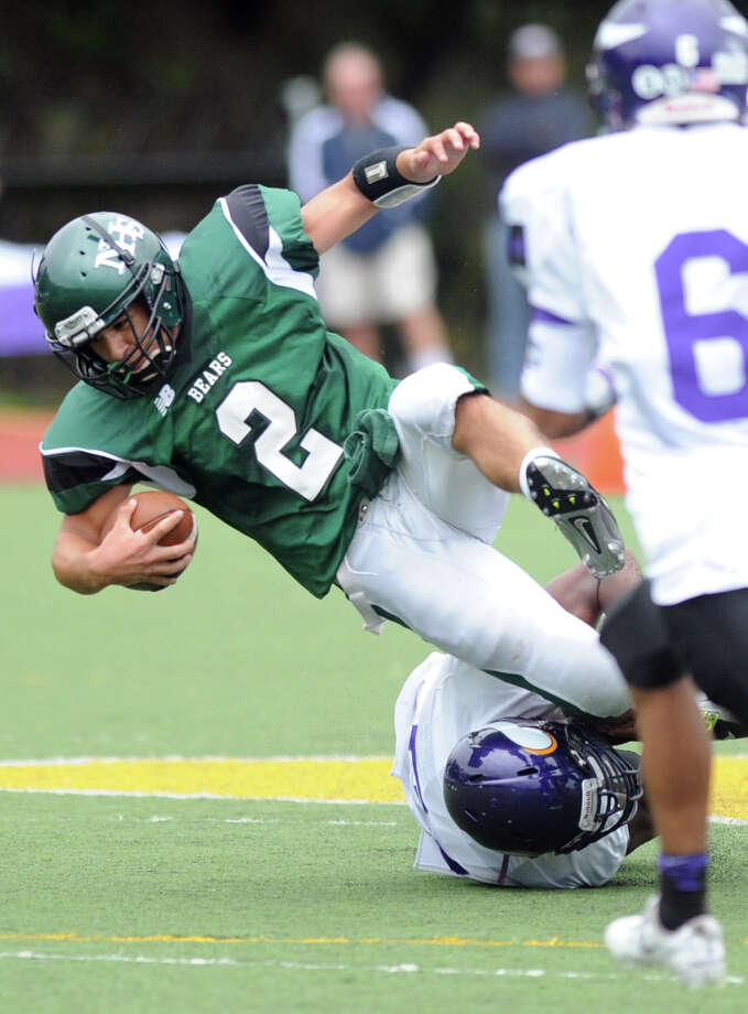 Norwalk's Andy Lovo carries the ball during Saturday's football game at Westhill High School on September 29, 2012. Photo: Lindsay Niegelberg / Stamford Advocate